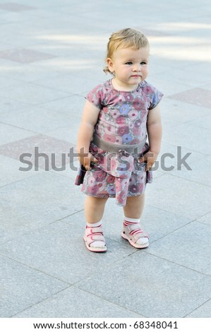 baby girl standing alone, she wants to walk