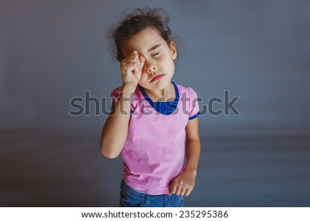 baby girl t her eyes - stock photo