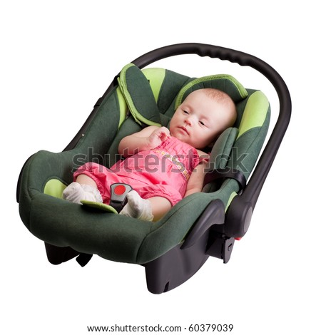 Baby girl toddler wearing pink dress lying comfortable in car seat, isolated on white - stock photo