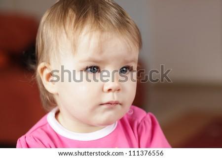 Baby girl watching tv at home - stock photo