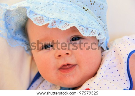 baby girl with bonnet - stock photo
