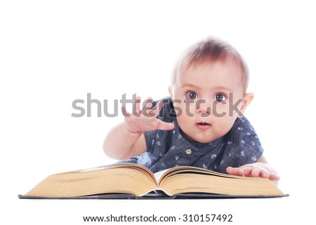 Baby girl with book sitting on white background
