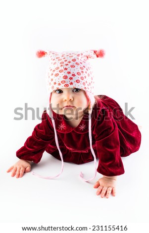 Baby girl with christmas red costume - stock photo