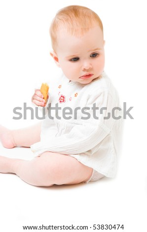 baby girl with cookie