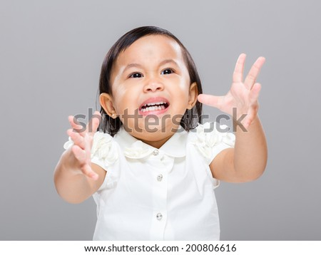 Baby girl with emotional temper - stock photo