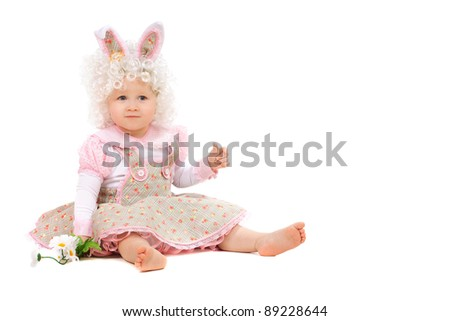 Baby girl with flowers in hand wearing a dress. Isolated