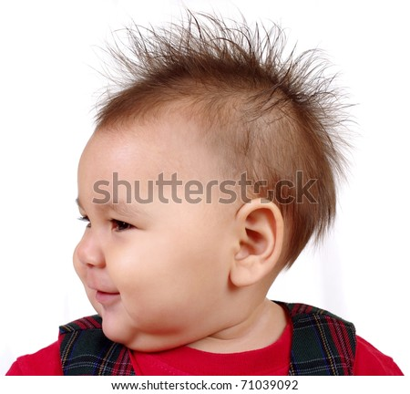 baby girl with funny spiky hair, on white background - stock photo