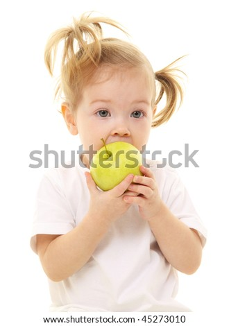 Baby girl with green apples