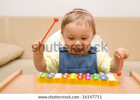 baby girl with instrument - stock photo