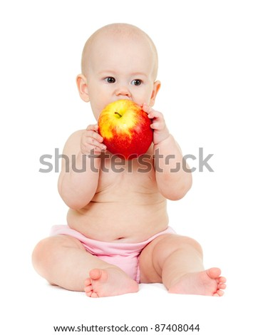 baby girl with red apple