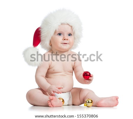baby girl with Santa Claus hat - stock photo