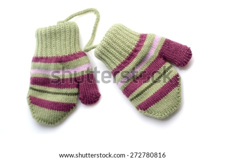Baby gloves on white background - stock photo