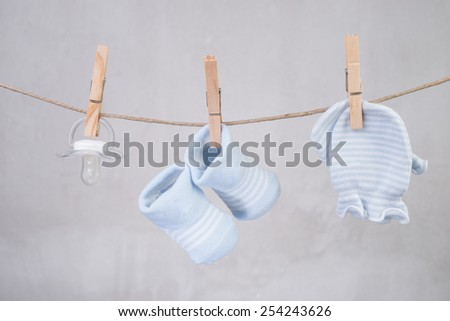 Baby goods hanging on the clothesline  - stock photo