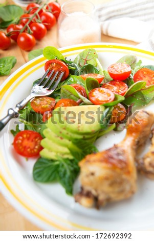 Baby Greens and Tomato Salad Served with Chicken Drumsticks