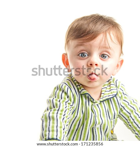Baby grimacing to the camera on white background - stock photo