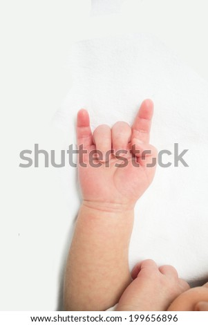 Baby hand in 'I love you' sign - stock photo