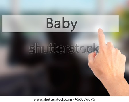 Baby - Hand pressing a button on blurred background concept . Business, technology, internet concept. Stock Photo