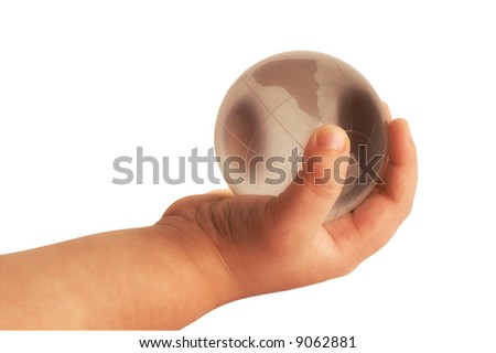 baby hand with globe - stock photo