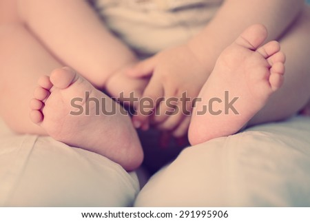 Baby hands and feet, closeup - stock photo