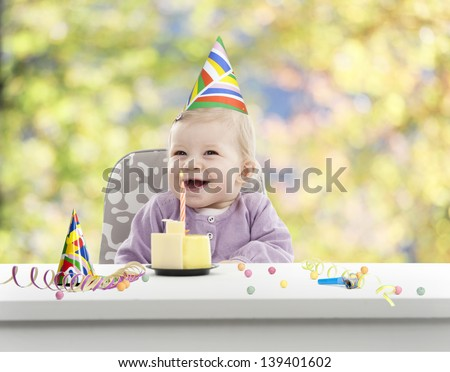 baby having her first birthday, green and yellow blurred background