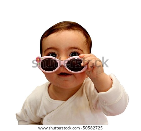 Baby holding her sunglasses - stock photo