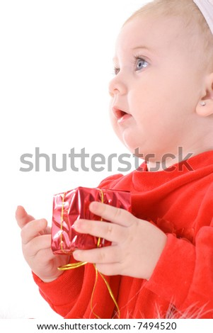 baby holding present side - stock photo