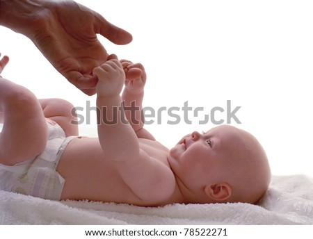 baby holding the hand of parent - stock photo
