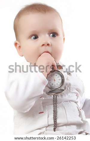 baby holds pocket watches - stock photo