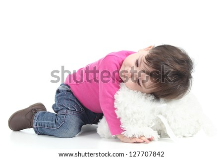 Baby hugging a teddy bear on a white isolated background - stock photo