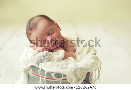 Baby in a bucket - stock photo