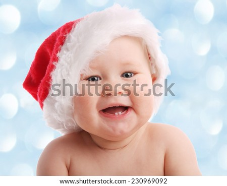 Baby in a Christmas hat. Happy child - stock photo