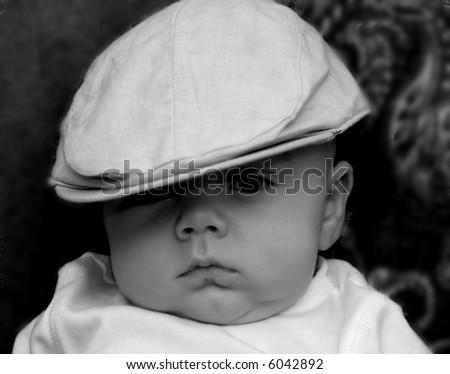 baby in a newsboy hat black and white, Irish Baby - stock photo
