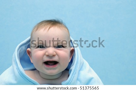 Baby in a towel shouts in the chamber