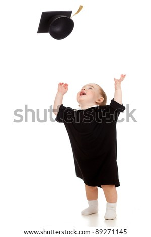 Baby in academician clothes  tossing up academical cap - stock photo
