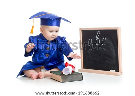 Baby in academician clothes  with book at  blackboard - stock photo