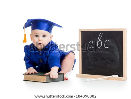 Baby in academician clothes  with book at chalkboard - stock photo