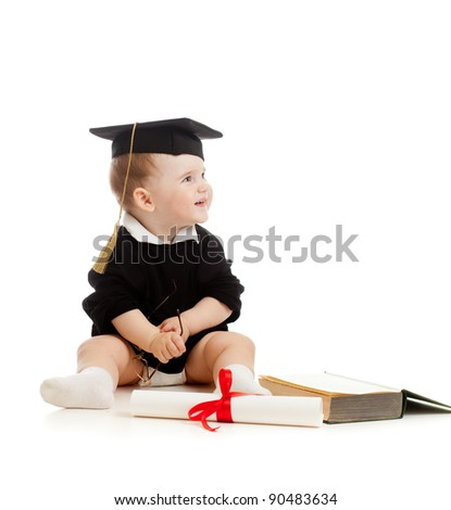 Baby in academician's  clothes  with roll and book - stock photo