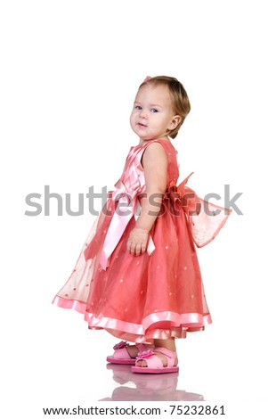 Baby in an elegant pink dress. isolated on white