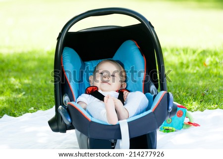 baby in baby seat - stock photo