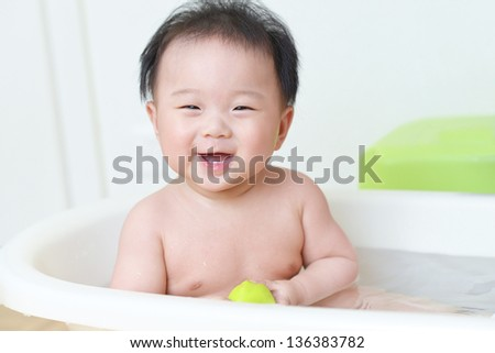 baby in bath - stock photo