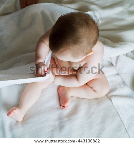 baby in bed at home, top view - stock photo