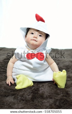 Baby in chicken costume  sc 1 st  Shutterstock : chicken costume toddler  - Germanpascual.Com