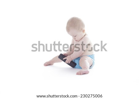 baby in cloth diaper holding tv remote isolated on white
