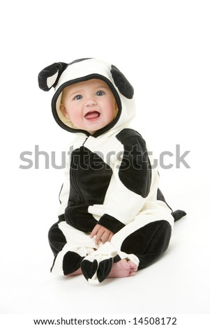 Baby in cow costume - stock photo