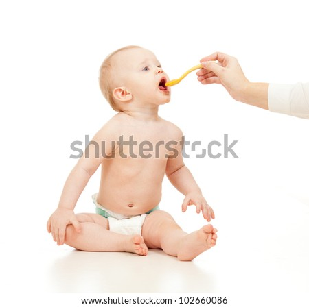 baby in diaper feeding on white background