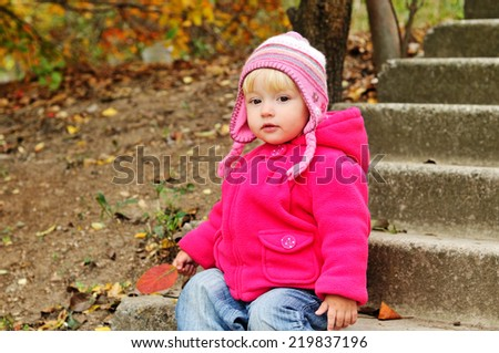 baby in fall time outdoors - stock photo