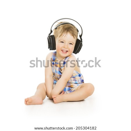 Baby in headphones listening to music. Child portrait over white background  - stock photo