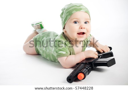 baby in khaki clothes with gun