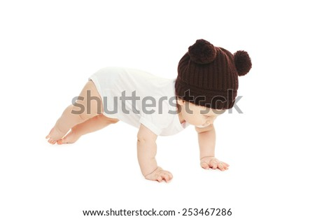 Baby in knitted hat on a white background - stock photo