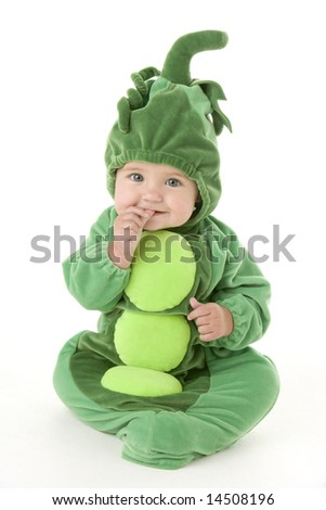 Baby in peas in pod costume - stock photo